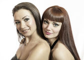 Two young female girlfriends, on a white background — Stock Photo