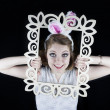 Pretty young woman with rabbit ears and picture frame — Stock Photo
