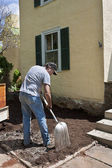 Man with shovel landscaping — Stock Photo