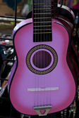 Pink guitar for sale — Stock Photo
