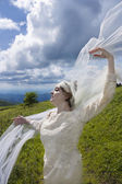 Bride with veil blowing in the wind — Stock Photo