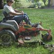 Landscaper on riding lawn mower — Foto Stock #48387821