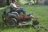 Landscaper on riding lawn mower — Stock Photo