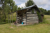 Front porch of rustic cabin — Stockfoto