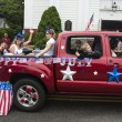 People ride in the back of a truck in the Wellfleet 4th of July Parade in Wellfleet, Massachusetts. — Stock Photo #49713141