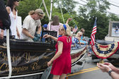 Man shucks oysters on a float in the Wellfleet 4th of July Parade in Wellfleet, Massachusetts. — Stock Photo