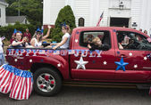 People ride in the back of a truck in the Wellfleet 4th of July Parade in Wellfleet, Massachusetts. — Stock Photo
