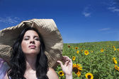 Beautiful woman in sunflower field — Stock Photo