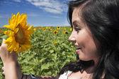 Beautiful woman holding sunflower — Stock Photo