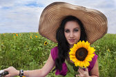 Beautiful woman with sunflower — Stockfoto