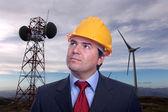 Man portrait construction hat on Eolic energy turbines backgroun — Stock Photo