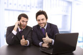 Two business men with laptop computer — Stock Photo