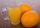 Glasse of orange juice and fruits — Zdjęcie stockowe