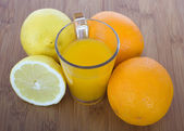 Glasse of orange juice and fruits — Stock Photo