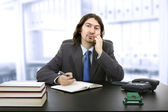Businessman sitting at the desk — Stock Photo