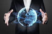 Businessman holding holographic globe — Stock Photo