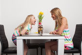 Mother and daughter have fun — Stock Photo