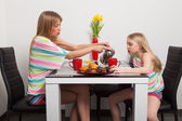 Mother and daughter drink tea — Stock Photo