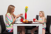 Teatime with red cups — Stock Photo