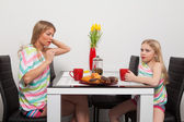 Mother and daughter have teatime — Stock Photo