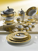 White tableware set with gold trim — Stock Photo