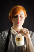 "Young Woman Tasting White Substance Marked ""X"" — Stock Photo"