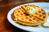Tradition waffle with butter in white plate on the table  — Stock Photo