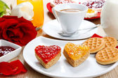 Breakfast with love and red hearths of jam — Stock Photo