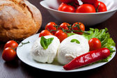 Mozzarella, vegetables and tomatoes — Stock Photo