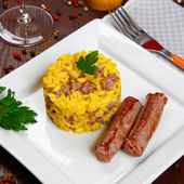 Risotto with sausages and saffron — Stock Photo
