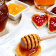 Waffle with honey and jam on a dish — Stock Photo