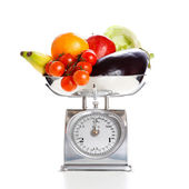 Vegetables and fruits on a weighing scale — Stock Photo