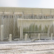 Stock Photo: Frozen breakwater and bus stop after winter storm