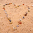 Heart of sea stones on sand — Stock Photo