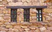 Stone wall with wooden window — Stock Photo