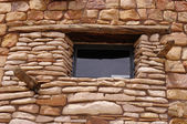 Decorative stone wall with window — Stock Photo