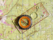 Walkers compass and on a topo map — Stock Photo
