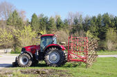 Red tractor for plowing on grass — Stockfoto