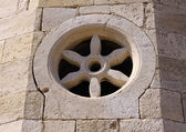 Stone rudder - window on church in Emona, Bulgaria — Stock Photo