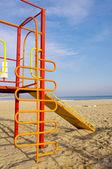 Colorful children slide on Beach — Stock Photo