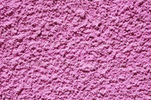 Pink rough plaster on wall — Stock Photo