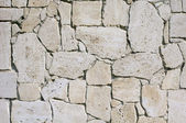 Wall lined with limestone slabs — Stock Photo
