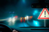 Bad weather driving - night driving - caution — Stock Photo