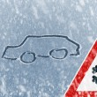Winter driving - snow on ice covered windshield — Stock Photo #39221143