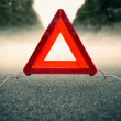 Caution fog - warning triangle on foggy road — Stock Photo #39221949