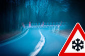 Night driving - caution - curvy road — Стоковое фото