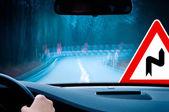 Night driving - caution - curvy road — Stock Photo