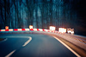 Night driving - caution - curvy road — Stock Photo