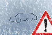 Winter driving - snow on an ice covered windshield — Stock Photo