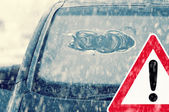 Winter driving - icy windshield — Stock Photo